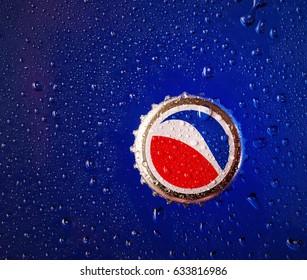 POLTAVA, UKRAINE - APRIL 29, 2017: Pepsi cap on a blue background