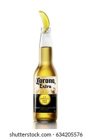 POLTAVA, UKRAINE - APRIL 29, 2017:Bottle of Corona Extra Beer with lime slice.Corona, produced by Grupo Modelo with Anheuser Busch InBev, is the most popular imported beer in the US.