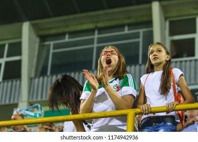 POLTAVA, UKRAINE - AUGUST 18, 2018: Fans of FC Vorskla during the match of the Ukrainian Premier League Vorskla – FC Mariupol at the Oleksiy Butovsky Vorskla Stadium