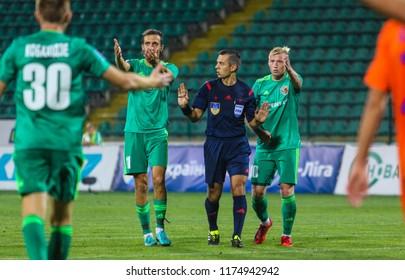 POLTAVA, UKRAINE - AUGUST 18, 2018: The players of FC Vorskla Vyacheslav Sharpar and Vladyslav Kulach prove the right to the referee during the match of the Ukrainian Premier League Vorskla – Mariupol