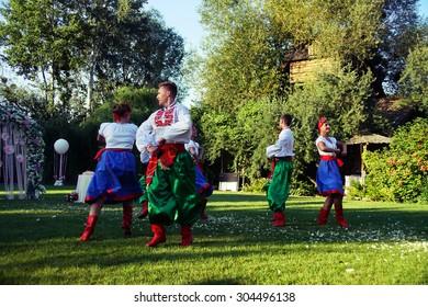 POLTAVA, UKRAINE - AUGUST 2015: a local cossack dancing group dances in a park. Ukrainians love to dance and sing.