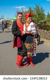 Poltava , Ukraine - August 22, 2018: Devil and Solokha - characters of the writer Gogol.The Sorochensky Fair . Woman in national costume of Ukrainian and man in a devil costume.Man and woman