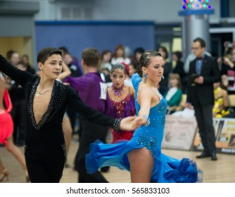 POLTAVA, UKRAINE - December 4, 2011: Unidentified young participants engaged in action during the national ballroom dance tournament. A bit of grain in effect.