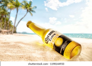 POLTAVA, UKRAINE - February 10, 2018: Corona bottle at the beach with lime fruit ready to drink. Corona Extra is produced in Mexico and exported to all other countries all over the world.