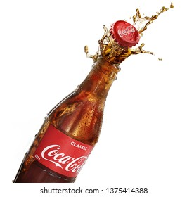 POLTAVA, UKRAINE - February 10, 2018: Splash bottle coca cola on a white background.Coca-Cola is a carbonated soft drink sold in stores, throughout the world.