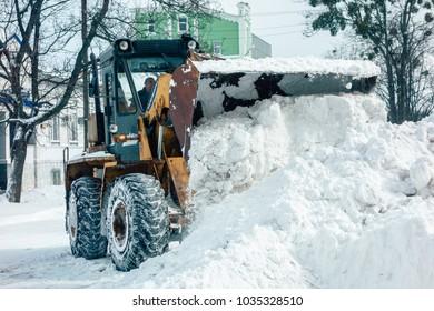POLTAVA, UKRAINE - FEBRUARY 28, 2018:  snow sweeper works on the snowy street