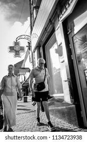 POLTAVA, UKRAINE - JULY 15,2018: old people on the street of Poltava in the summer sunset light