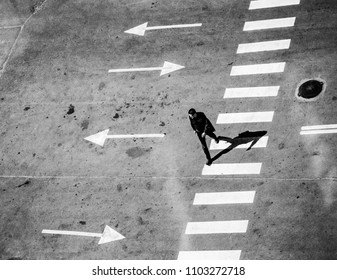 POLTAVA, UKRAINE - JUNE 1, 2018: man crossing road view from above
