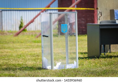 POLTAVA, UKRAINE - JUNE 25, 2019: The ballot box for Ukrainian elections is on a green lawn