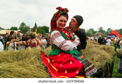 POLTAVA, UKRAINE - JUNE 9, 2019: Ukrainian actors in the role of Solokha and Chort from the work of Nikolai Gogol at the National Sorochinskaya Fair