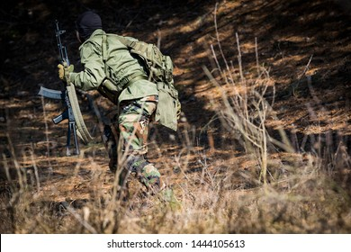POLTAVA, UKRAINE - MARCH 16, 2019: Game - an imitation of hostilities between the Irish National Army of Protestants and the airsoft game of the British Regular Army.