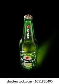 POLTAVA, UKRAINE - MARCH 22, 2018: Single Bottle of Heineken Premium Lager Beer. Heineken is a premium brand lager beer brewed in Holland by the Heineken Brewing Company
