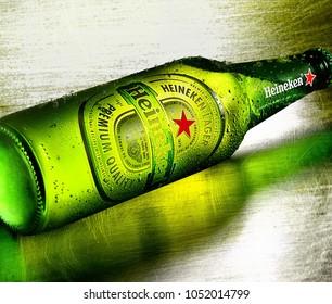 POLTAVA, UKRAINE - MARCH 22, 2018: Bottle of Heineken beer lies on a metal surface. Heineken Lager Beer is the flagship product of Heineken International.
