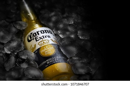 POLTAVA, UKRAINE - MARCH 22, 2018: Bottle of Corona beer  on a bed of ice.Corona Extra is produced in Mexico and exported to all other countries all over the world.