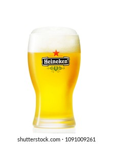 POLTAVA, UKRAINE - MARCH 22, 2018: A Glass of beer Heineken Lager on a white background.Heineken Lager Beer is a pale lager beer produced by the Dutch brewing company Heineken International