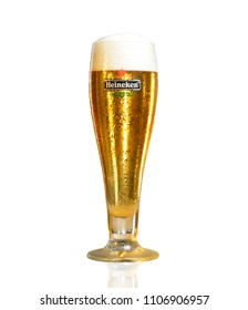 POLTAVA, UKRAINE - MARCH 22, 2018: A Glass of beer Heineken Lager on a white background.Heineken Lager Beer is a pale lager beer produced by the Dutch brewing company Heineken International