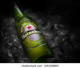 POLTAVA, UKRAINE - MARCH 22, 2018:Bottle of Heineken beer on a bed of ice. Heineken Lager Beer is the flagship product of Heineken International.