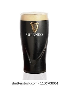 POLTAVA, UKRAINE - MARCH 22: Pint of Guinness, the popular Irish beer on a white background. Guinness beer has been produced since 1759 in Dublin, Ireland.