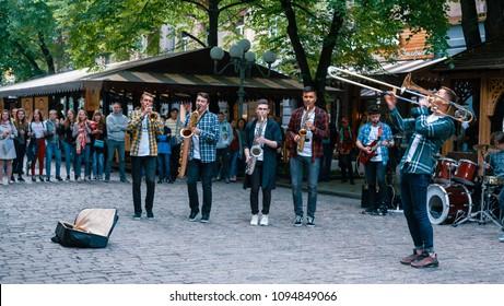 POLTAVA, UKRAINE - MAY 21, 2018: street band performance with public on background