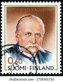 POLTAVA, UKRAINE - May 24, 2020. Vintage stamp printed in Finland circa 1973 show 100th anniversary of the birth of President Kyosti Kallio