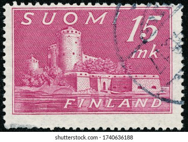 POLTAVA, UKRAINE - May 25, 2020. Vintage stamp printed in Finland circa 1945 show old castle