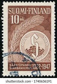 POLTAVA, UKRAINE - May 25, 2020. Vintage stamp printed in Finland circa 1947 show 125th anniversary of the first Finnish Savings Bank