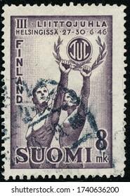POLTAVA, UKRAINE - May 25, 2020. Vintage stamp printed in Finland circa 1946 show Working class sports