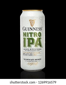 POLTAVA, UKRAINE - OCTOBER 28, 2018: Beer Guinness Nitro IPA can on а black background.  Guinness beer has been produced since 1759 in Dublin, Ireland.