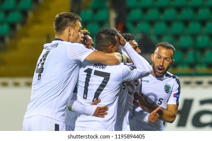 POLTAVA, UKRAINE - OCTOBER 3, 2018: Footballers of Portuguese Sporting are glad to score a ball during the match of the UEFA Europa League Vorskla - Sporting at the Vorskla stadium