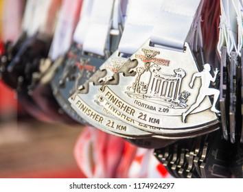 POLTAVA, UKRAINE - SEPTEMBER 2, 2018: Medals for finishers of the Poltava semi-marathon during the Poltava Nova Poshta semi-marathon at the Theater Square