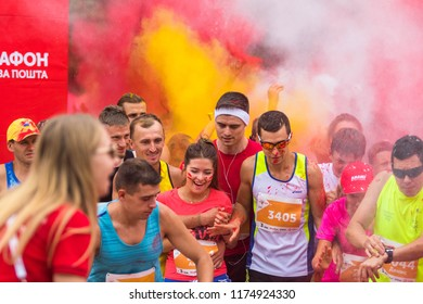 "POLTAVA, UKRAINE - SEPTEMBER 2, 2018: Runners will start during a ""color"" run during the Poltava Nova Poshta semi-marathon at the Theater Square"
