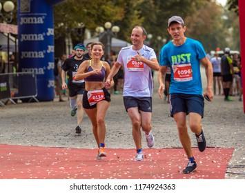 POLTAVA, UKRAINE - SEPTEMBER 2, 2018: Marichka Padalko and Yehor Soboliev during the Poltava Nova Poshta semi-marathon at the Theater Square