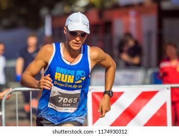 POLTAVA, UKRAINE - SEPTEMBER 2, 2018: Runner during the run during the Poltava Nova Poshta semi-marathon at the Theater Square