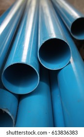 Poly Vinyl Chloride.Blue plastic pipe. Plastic pipe for conveyor.Equipment used in the work. Tubes PVC water pipes stacked in the warehouse or construction site.