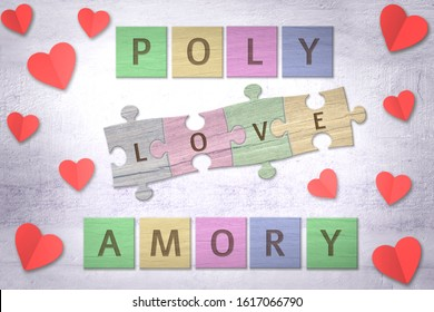 Polyamory word made with wooden colored puzzle pieces and red paper hearts on a table. Polyamorous concept.