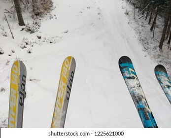 Polyanitsya / Ukraine - January 28 2018: Winter ski landscape. Skiing slopes and chairlifts in the Carpathian mountains. Sport concept. Panorama of top of hills. Pairs of yellow and blue ski elan