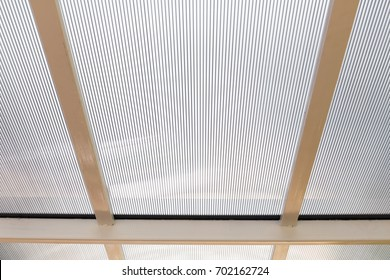 Polycarbonate awning roof on metal beam structure