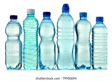 Polycarbonate plastic bottle of mineral water isolated on white background with visible drops of water