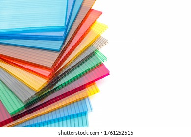 Polycarbonate plastic sheets panels images. PC hollow sheet for translucent roofing on white background. Many colors