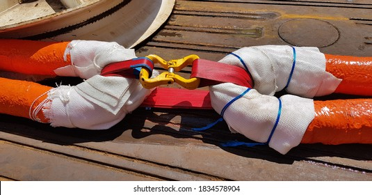polyester ropes connected by a sling and a hammer lock