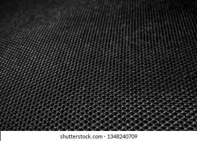 Polyester texture. Plexus black threads. Blurred background. Fabric.