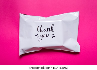 polyethylene envelope on pink background