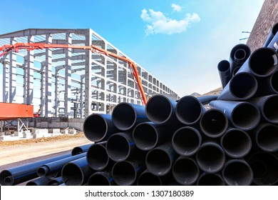 The polyethylene pipes in the construction site. Polyethylene pipe is usually black in color due to the addition of 3-5% of carbon black being added to the clear polyethylene material.