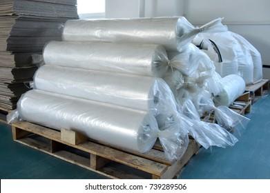 polyethylene in rolls on wooden pallet in industrial premises