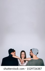 Polygamy lifestyle. Gender equality acceptance. Happy confident woman with two men.