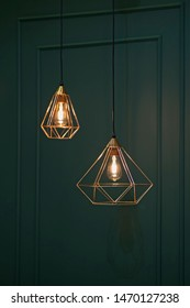 Polygonal chandelier, gold, brass, different shapes of a triangle. Fashion design chandeliers.