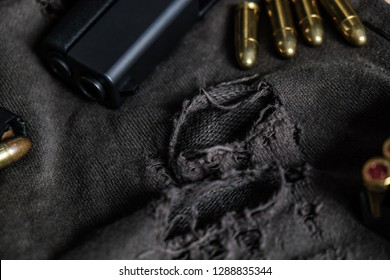 Polymer gun with FMJ 9mm automatic pistol ballistic on cloth background, Violence concept