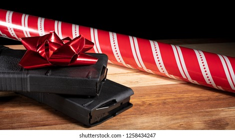 Polymer gun magazines with red Christmas ribbon and wrapping paper