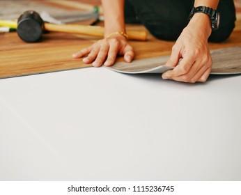 Polymer vinyl sheet installing on ceramic tile for renovation works