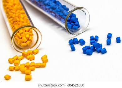 Polymeric dye. Plastic pellets. Colorant for plastics. Pigment in the granules. Polymer beads.